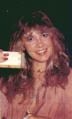 Stevie ~ ☆♥❤♥☆ ~ looking very pleased with whatever she's holding in her right hand ~ love her sparkling brown eyes, her layered hair and her long red nails