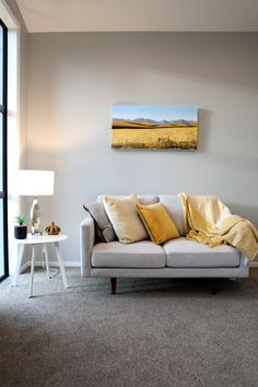 Brighten up your living room by working yellow into your palette. This versatile colour instantly brightens and adds warmth to your room. #yellowlivingroom #livingroom #lounge #colour #interiordesign #kamakaplan #generationhomesnz 4 Bedroom House Plans, Sofa, Couch, Family Rooms, Palette, Lounge, Colour, How To Plan, Living Room