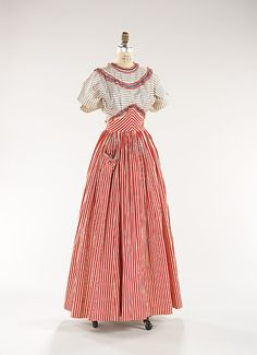Gilbert Adrian (American, 1903–1959). Dress, ca. 1944. American. Brooklyn Museum Costume Collection at The Metropolitan Museum of Art, Gift of the Brooklyn Museum, 2009; Gift of Diana S. Field, 1964 (2009.300.335a, b) | Here, the designer paired red and white striped cotton with red, white and blue eyelet to create a dress that embodies both his own aesthetic and post-war American patriotism.