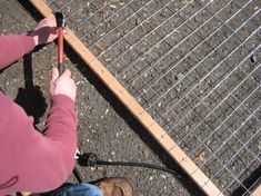 We made a trellis for the garden last fall, but my post about it was rather light on details. We built 3 more of them during our spring break, so here are detailed building and installation instruc… spring break ideas How to: inexpensive garden trellis Garden Yard Ideas, Diy Garden, Garden Landscaping, Landscaping Ideas, Wire Trellis, Garden Trellis, Cucumber Trellis, Trellis Design, Trellis Ideas