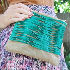 Sewing tutorial shows you how to make this textured leather clutch.