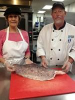Two contestants in the #Sodexo Senior Chef Challenge prep a lovely rock bass fish. The contest paired Sodexo chefs from three retirement communities with the very residents they serve.