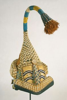 Africa | Mask from the Kuba people of the DR Congo | Glass beads, wicker, Kuba cloth, raffia, cowries, leather