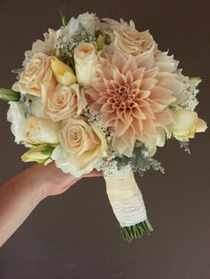 Peaches and cream wedding flowers.  Bridal bouquet with dahlias, roses,  lisianthus and babies breath