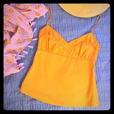 J. Crew crossover cami EUC Gorgeous orange citrus colored woven cotton cami with satin spaghetti straps and piping detail. From J. Crew, Size 2, TTS. Zipper closure on side. Only worn 2 to 3 times. Perfect condition. Please ask any questions you may have! J. Crew Tops Camisoles