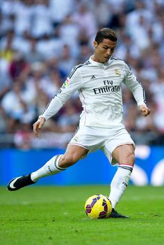 Cristiano Ronaldo of Real Madrid CF scores their opening goal from a penalty shot during the La Liga match between Real Madrid CF and FC Barcelona at Estadio Santiago Bernabeu on October 25, 2014 in Madrid, Spain.