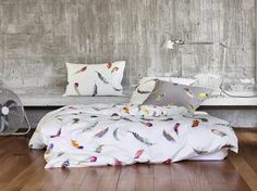 Colorful Watercolor Feather Pattern Bedding - Zimmer Rohde Birds Gallery Blanc.  This colorful modern bedding has bands of vivid watercolor bird feathers in a range of colors on a light white background.   http://www.jbrulee.com/cat-schlossberg-bonjour-of-switzerland-bedding.cfm