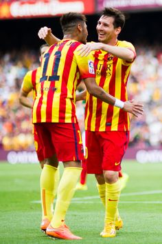 Neymar Santos Jr (L) of FC Barcelona celebrates with his teammate Lionel Messi after scoring his second team's goal during the La Liga match between FC Barcelona and Athletic Club at Camp Nou on September 13, 2014 in Barcelona, Catalonia.