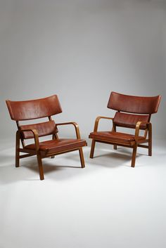 Magnus Stephensen; Mahogany and Leather Lounge Chairs, 1963.