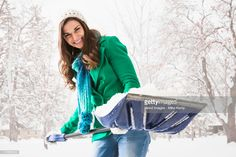 Stock Photo : Caucasian woman shoveling snow outdoors