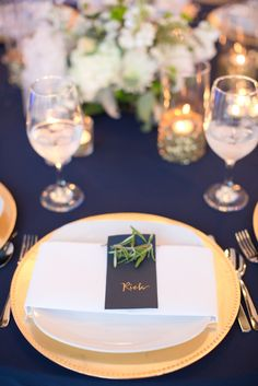 Navy and blush pink color scheme, light and dark pink peonies, and gold accents.