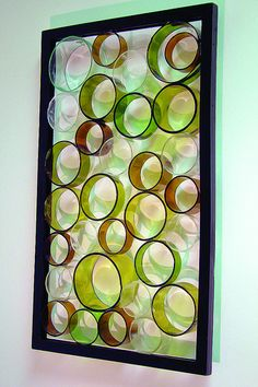 Ringed Sculpture made of glass bottle rings by Rita LeVine on Flickr. This could be a room divider or a sun catcher.