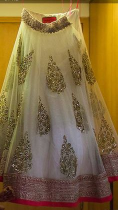 gorgeous bridal lehenga. Will look fab with a red blouse and red net dupatta