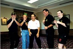 JKD instructors Chris Kent, Ted Wong, Richard Bustillo, and Andy Gibney clown around at the First European Jun Fan JKD seminar in England.