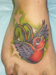 Colorful cartoon swallow tattoo