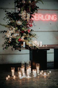 industrial wedding with neon 'Everlong' sign