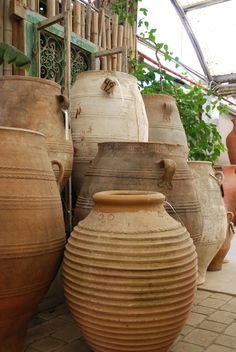 Here is a collection of our antique Greek terracotta! These large oil jars add the perfect vintage touch to your garden design.