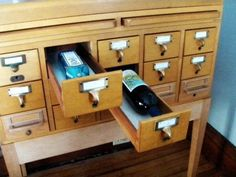 To add to our posts about libraries, other book-related matters, and wine-related repurposing, there's this: An obsolete card catalog repurposed as a minibar. Need we say more?! (photo via The Sugar Monster on Flickr)