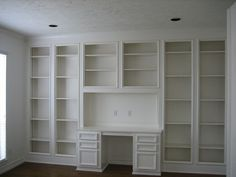 study with built in desk and shelves by shoarora