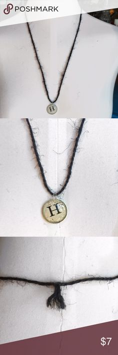 Handmade Black Twine 'H' Initial Necklace Beautiful handmade black twine necklace featuring a silver-coated beige pendant with the initial 'H' in the center. Approx. 12.5 inches, including pendant. Only one available. Handmade Jewelry Necklaces