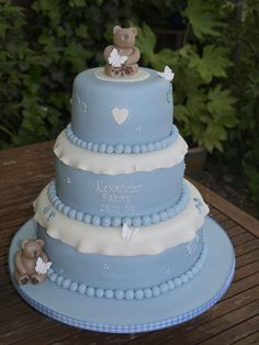 All sponge 3 tier stacked pale blue and ivory christening cake with bears