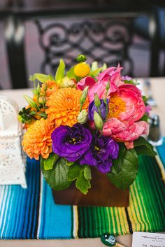 HECTOR and JESSICA's  Fiesta wedding flowers at El Paseo Mexican Restaurant in Santa Barbara, CA, designed by www.artandsouleventsla.com, and featured on @Offbeat Bride , flowers by Juniper Designs, Santa Barbara