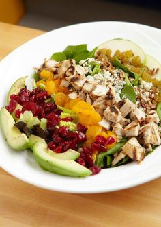 Citrus Spring Salad: Crisp mixed greens, topped with tender chicken breast, avocado, pecans, apples, raisins, dried cranberries, mandarin oranges, and blue cheese crumbles. Served with fat-free citrus vinaigrette.