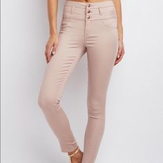 High waisted pants! Never worn! These high-waisted skinny jeans are so comfy! A pretty, light rose gold color perfect for spring!  They're stretchy too  Size 6 from Charlotte Russe. Charlotte Russe Jeans Skinny