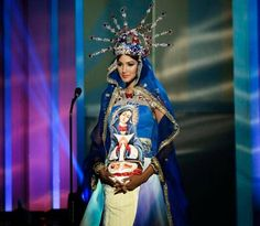 Miss Dominican Republic Kimberly Castillo poses for the judges during the national costume show at the 63rd annual Miss Universe preliminary competition at FIU on Wednesday, Jan. 21, 2015.