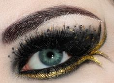 Katniss catching fire makeup..obsessed