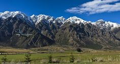 Flying high: A small aircraft comes in to land at Queenstown Airport in New Zealand...