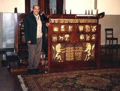 Jaime Fischman beside the tebah -- the reader´s lectern -- during a visit to the Sociedad de Beneficencia Sephardi in Lima, Peru.