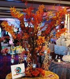 Manzanita tree centerpiece with pretty orange flowers - looks like autumn tree