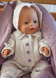 Baby doll Kine's lovely suit and a lilac blanket