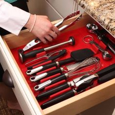 The drawer decor system is a sleek way to custom organize your kitchen drawer with modern style and a splash of color. I can also see myself using this in the bathroom for curling irons and brushes...  $25