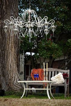 """DIY Solar Light Chandelier!! Find an old chandelier. Spray paint the colour of your choice including the chain to hang it. Remove all the wiring. Add garden solar lights of your choice.                                                                                                                                                     More"
