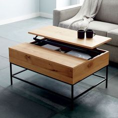 INDUSTRIAL COFFEE TABLE | Industrial Storage Coffee Table by west elm | Discover more coffee tables ideas: www.bocadolobo.com #moderncoffeetables #luxurycoffeetables