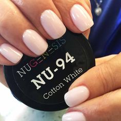 Soft white, pale pink hue nail color dip powder.