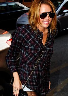Miley Cyrus. Her. Her outfit. Her glasses.