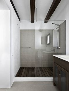 Jamie:  Probably my favorite bathroom.  look at that floor!  flippin' gorgeous.  just a smidge more modern rustic!
