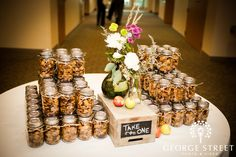 Yummy chex mix treats for the guests in their own mason jars. Sweet and also savory options
