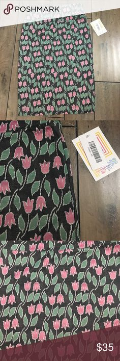 NWT Lularoe Flower Cassie size XS NWT Lularoe Flower Cassie. Size XS. Black background with pink and green. So pretty and nice material. Pencil skirt. Bundle and save 15% LuLaRoe Skirts Pencil