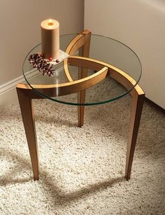 Steam-bending or bent laminations can be used to make this eyecatching design. From the February 2011 issue #188 Buy this issue now The design of this table is part of a series that I revisit from time to time. The original concept for the series was based on a pinwheel (a common example of which is a child's pinwheel on a stick that blows in the wind