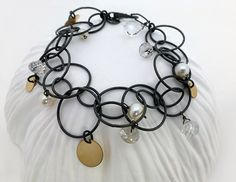 Oxidized sterling circle chain bracelet with quartz, pearls, and gold dots. Find it at www.calliope-jewelry.com
