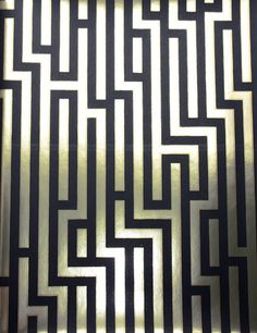 Fretwork Wallpaper  Black and gold metallic labyrinth style wallpaper  Width 	52 cms x 10 metres  Pattern Repeat 	53 cms  Care 	spongeable