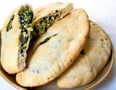 Spinach Tofu Calzones. -would like to try with vegan puff pastry dough. Will uses blended tofu instead silken tofu. Serve with tomato sauce