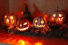 A nice collection of Jack-o-lanterns all alit for Halloween