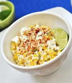 Esquites - This side dish is a staple on the streets of Mexico. It's sold at food carts, served in cups usually, and it's a great way to serve up this season's corn. This is a spicy recipe so if you prefer less heat, remove the seeds and vein Spicy Recipes, Mexican Food Recipes, Cooking Recipes, Mexican Corn In A Cup Recipe, Corn Recipes, Slow Cooker, Crockpot, Good Food, Yummy Food