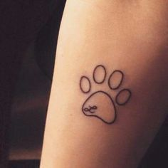 Small dog tatto with letter