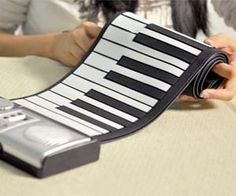 Enchant an audience with your skillful pianist abilities while on the go with this portable roll up piano. Perfect for setting up an impromptu piano concert, the roll up piano is light weight and makes a great gift idea for the traveling musician.